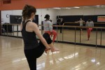 A student follows instructions on the next dance move from Cesar. Photo by Gabriela Jeronimo.
