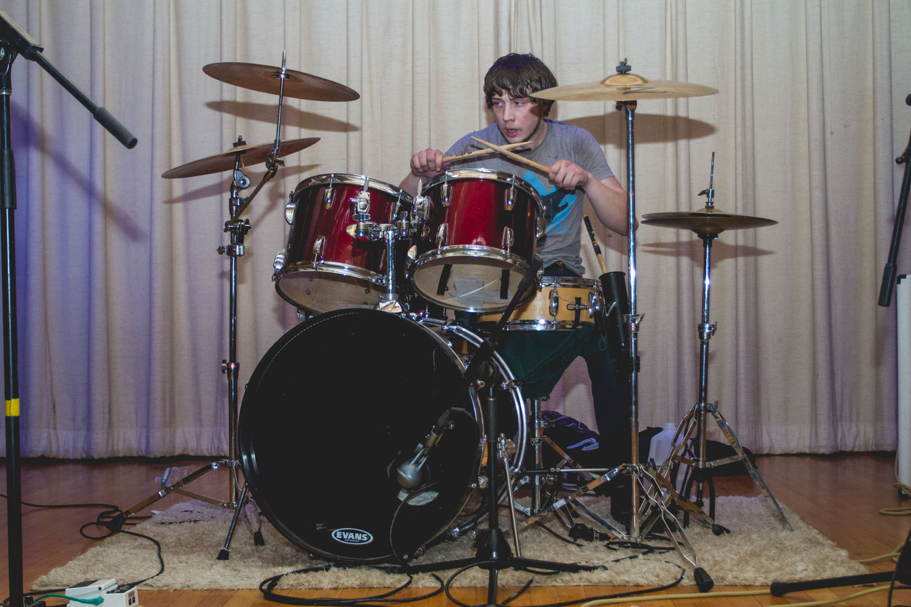 DIA's drummer, Aeden Plunkett, beating away on his drums at his show at St. Joseph's Church. Photo by Gabriela Jeronimo