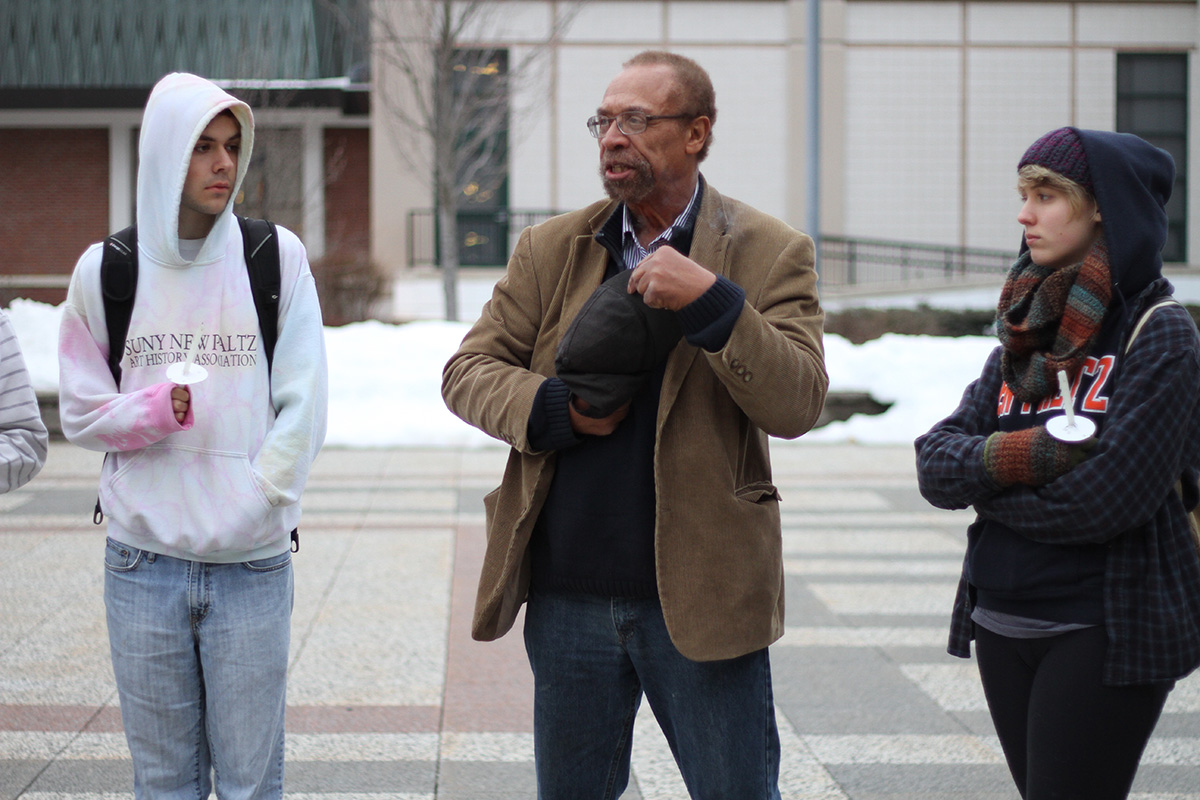 SUNY New Paltz Black Studies professor, Dr. Zelbert Moore, speaks during the vigil. Photo by Gabriela Jeronimo.