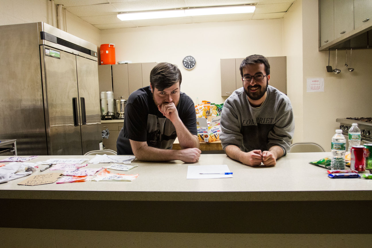 Volunteers, Matt Sherman and Matt Miccio, taking a break from selling snacks and refreshments. Photo by Gabriela Jeronimo