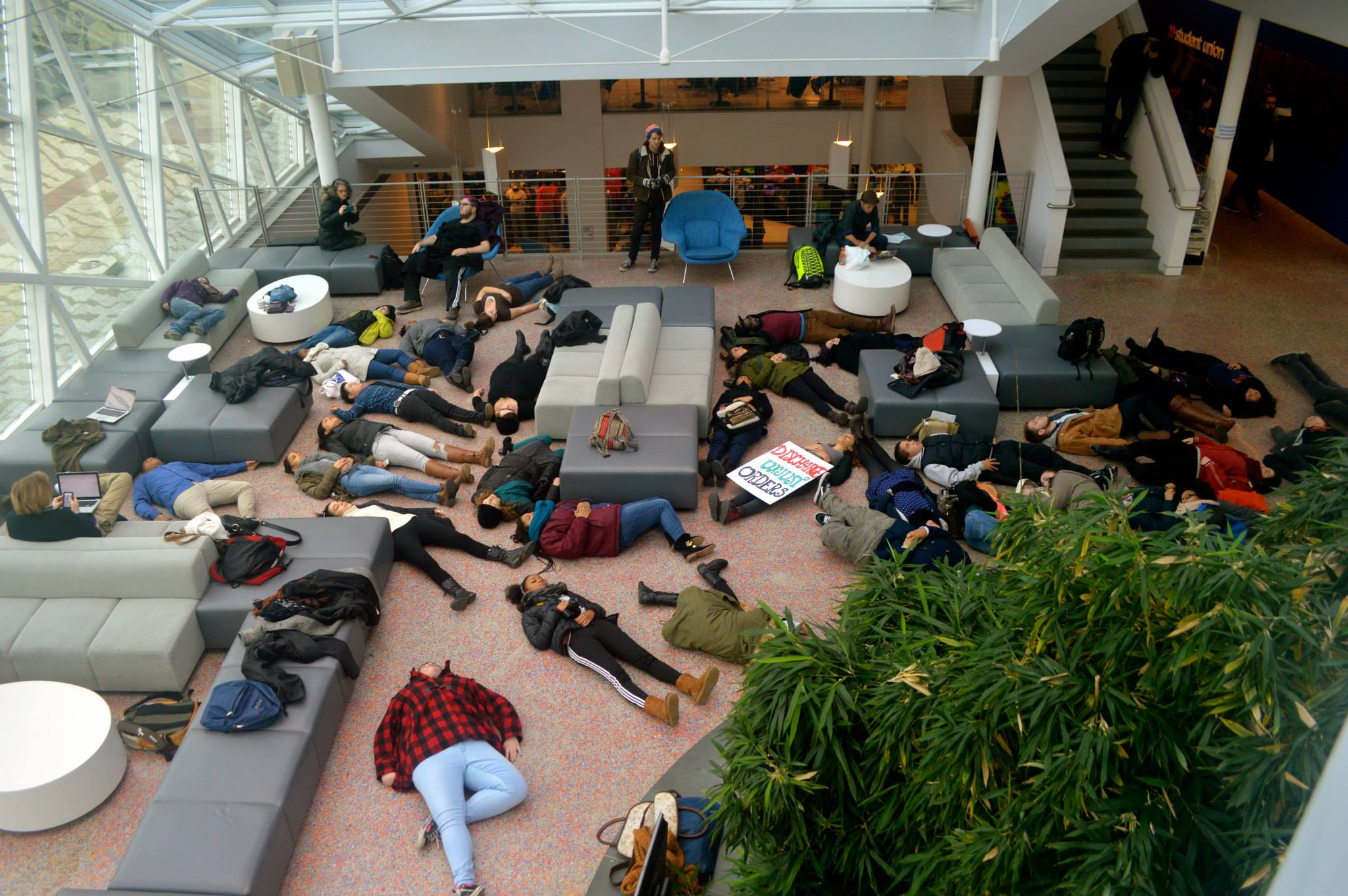 "Students hold a ""die-in"" in opposition to police brutality. Photo by Sarah Eames."