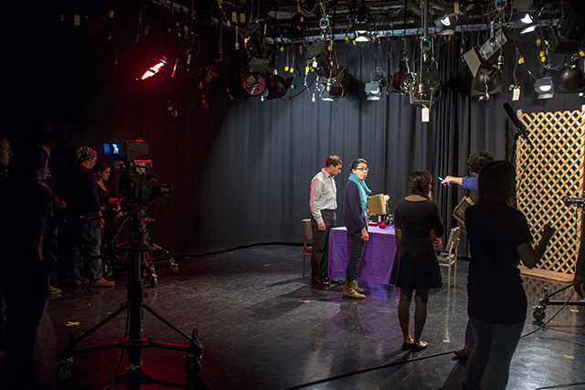 Students prepare for the first shoot of the day as Professor Dan Labbato directs the talent.   Photo by Vincent Carnevale