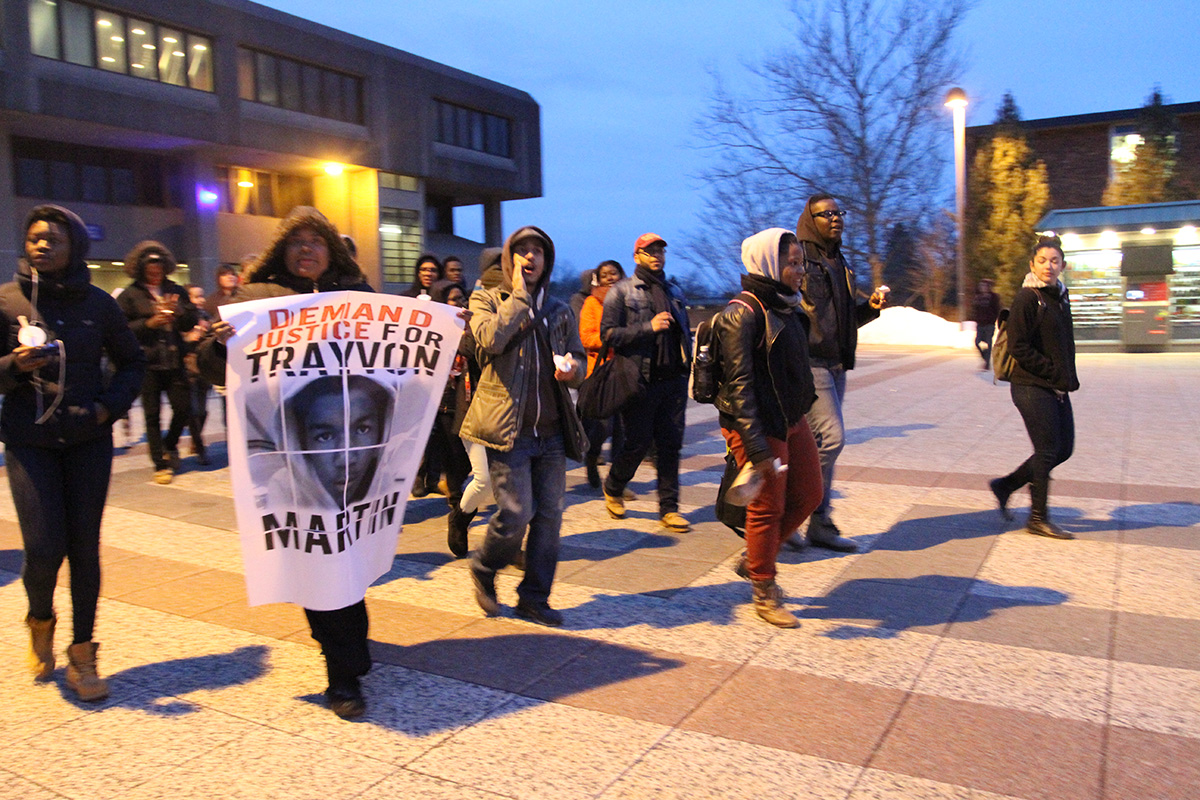 "Students who attended the vigil head out to march across campus while chanting ""Trayvon Martin."" Photo by Gabriela Jeronimo"