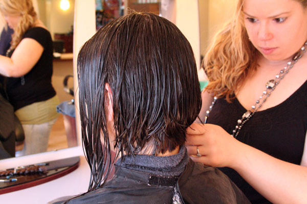 Amanda, a hair stylist at Studio One Hair Design in New Paltz cuts 11 inches off this woman's hair. Photo by Caterina DeGaetano.