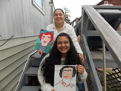 Josselin Valladares and her mother Glenia Gomez displaying Josselin's artwork