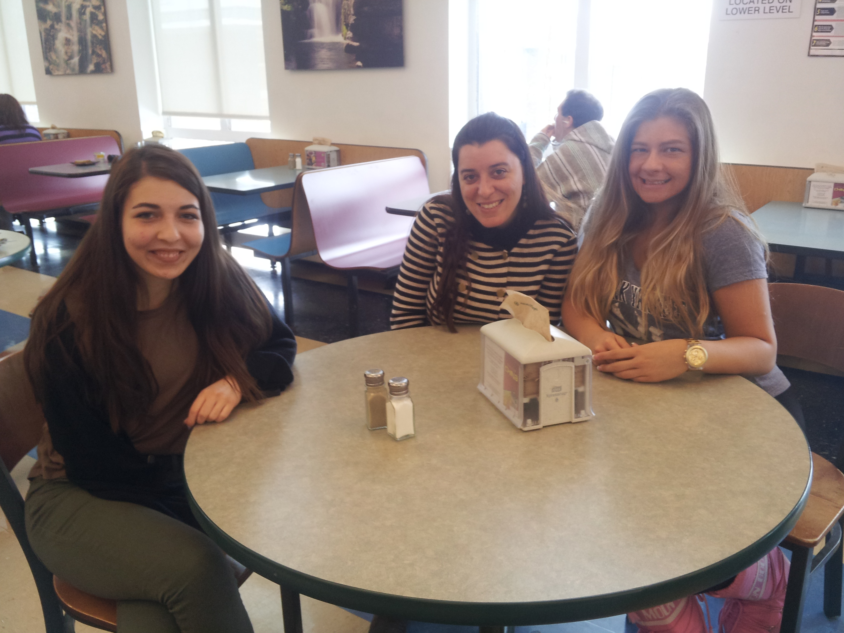 Third-year education majors, Su Basdemir, Tugba Aldanmaz and Elif Yilmaz from Middle East Technical University often meet for lunch together in Hasbrouck dining hall. Photo by Kelly Fay,