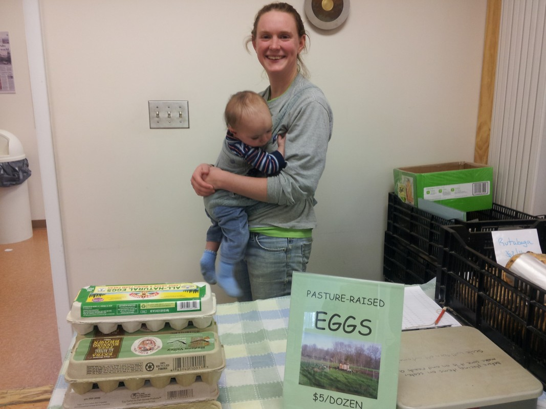 Becky Fullman and her son sell fresh eggs from Old Ford Farm. The family-run farm produces eggs, chicken, pork and vegetables. Photo by Kelly Fay.
