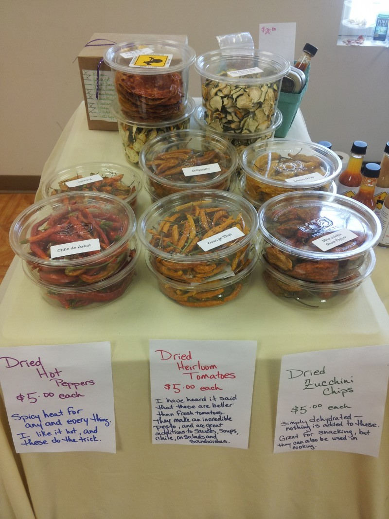 Dried hot peppers, zucchini chips and their signature heirloom tomatoes from Evolutionary Organics. Photo by Kelly Fay.