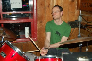 "Peter""Sticks"" Kaufman playing drums at Questionable Authorities'' 2011 graduation gig at Snug Harbor."