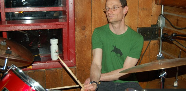 """Peter""""Sticks"""" Kaufman playing drums at Questionable Authorities'' 2011 graduation gig at Snug Harbor."""