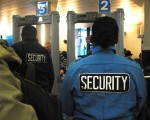 Once visitors wait in the line and make it to the first stop in the security process they have to go through what very much resembles airport security customs. After removing all outerwear, belts, electronics, etc., and putting them in a bin to go through the scanner, one must walk through the arch scanner. The room is filed with security guards moving people along and making sure everything is running smoothly. Photo by Emily DeFranco.