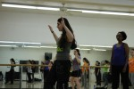 SUNY New Paltz zumba instructor, Liz Sydney, demonstrates a dance move to her class. Photo by Kate Bunster.