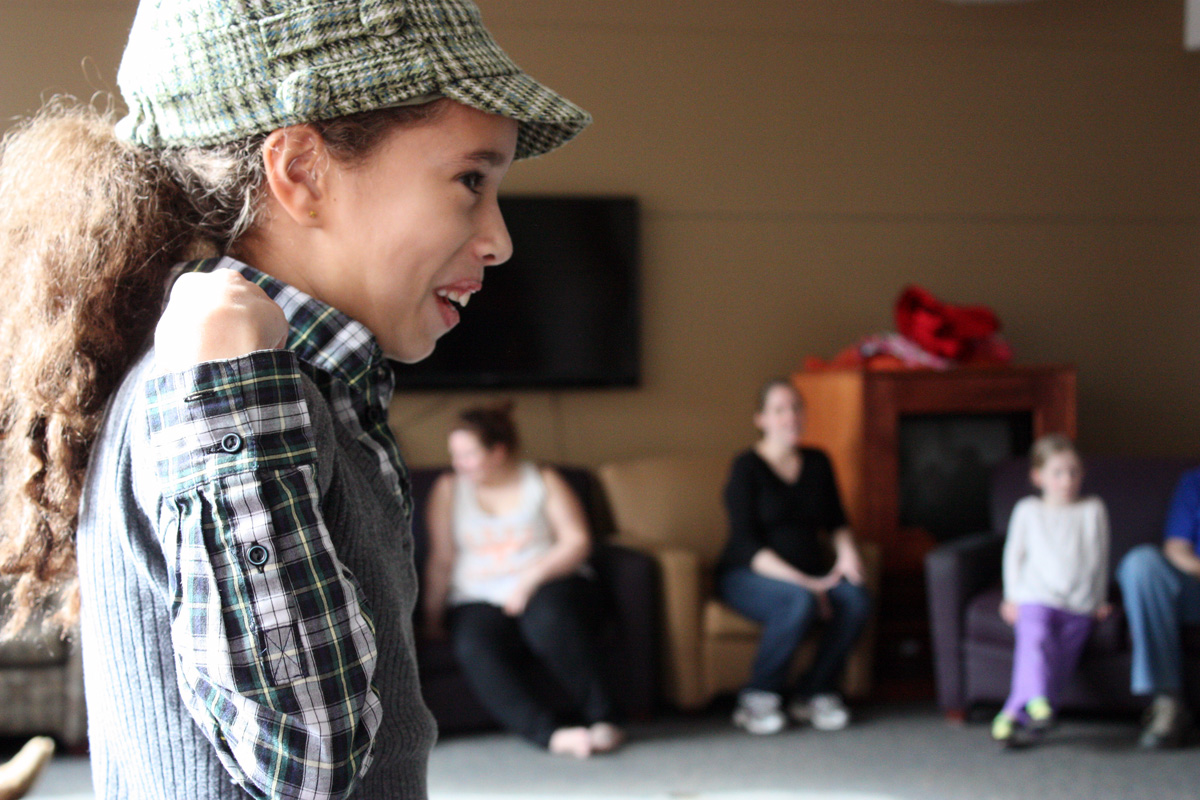 Samantha Shane, 10, laughs while playing silly games. Photo by Lauren Reid.