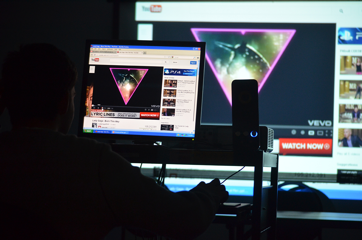 "He explains the significance of the upside down pink triangle in history and how it has even stayed relevant in today's media. He used Lady Gaga's music video ""Born this Way"" as an example. Photo by Jillian Nadiak"