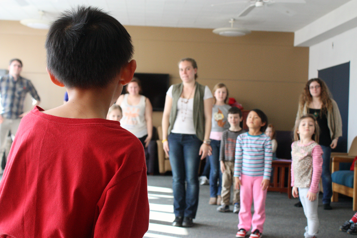 Tyler Wong, 8, leads a round of 'Simon says.' Photo by Lauren Reid.