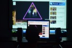 """He explains the significance of the upside down pink triangle in history and how it has even stayed relevant in today's media. He used Lady Gaga's music video """"Born this Way"""" as an example. Photo by Jillian Nadiak"""