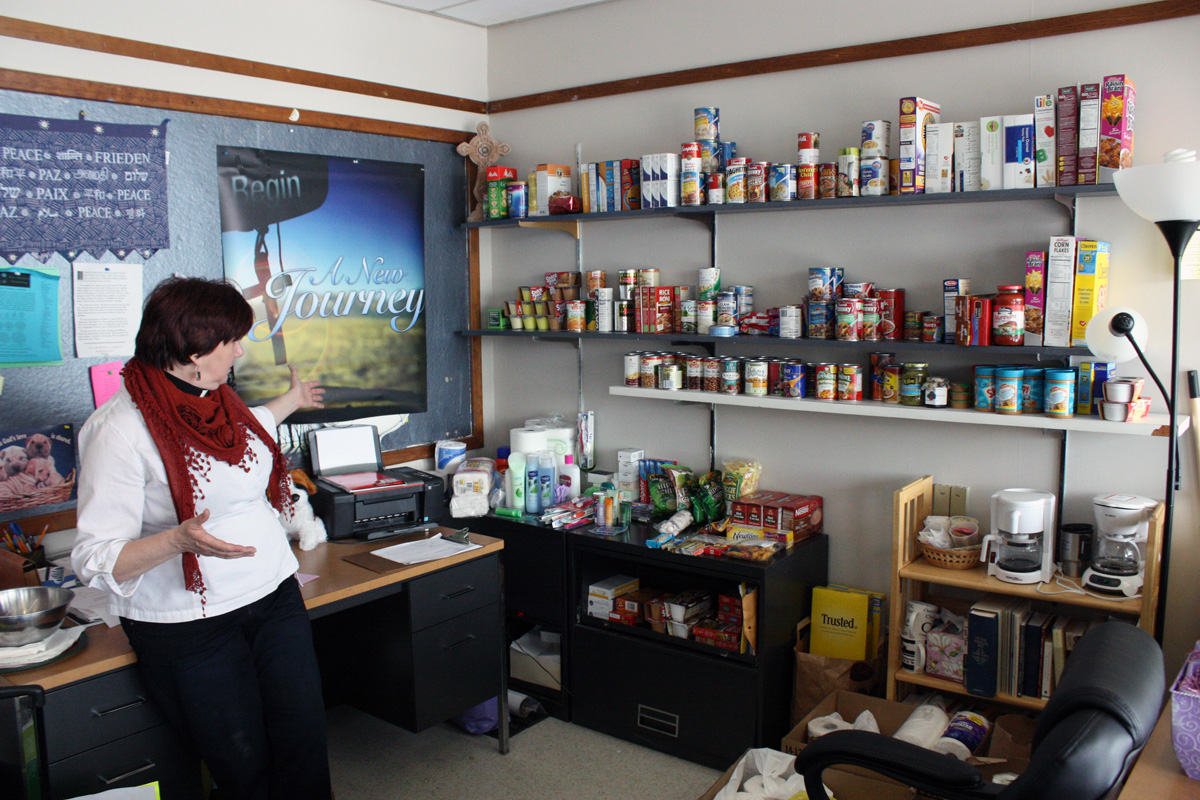 Pastor Smith gestures to the back corner of her office and explains how only a few days ago it was stocked to the shelf with food. Photo by Lauren Reid.