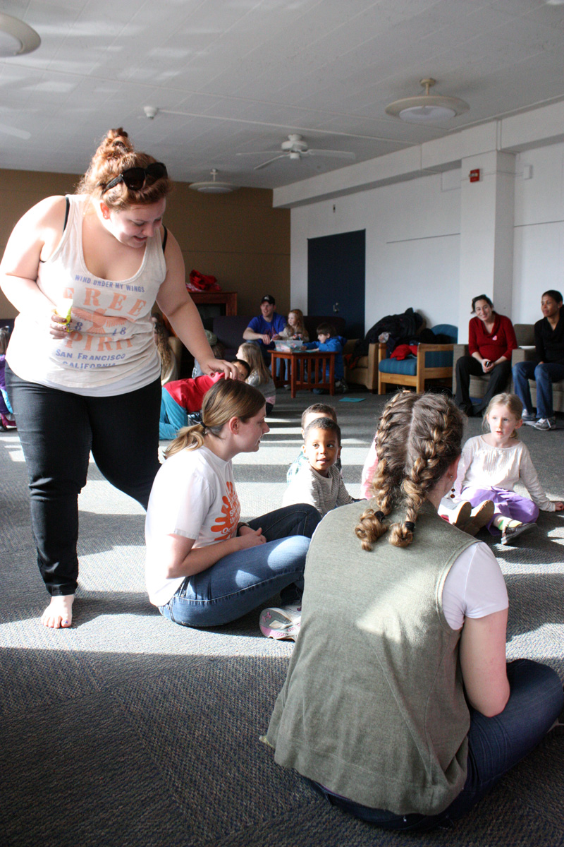 Graduate student Shayne Juliano plays 'duck, duck, goose' with some of the children. Photo by Lauren Reid.