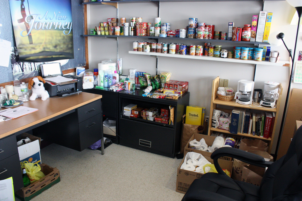 Pastor Smith stores the food for the campus food pantry in her office. She has even begun to store donations in her cubbies and under her desk. Photo by Lauren Reid.
