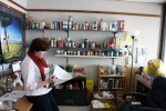 Pastor Dianna Smith looks over paperwork in her office, that she shares with the pantry. There are plans for additional shelves for future donations. Photo by Lauren Reid.