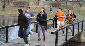 "A group of ""zombies"" chase the ""humans"" across a bridge over the pond on the SUNY New Paltz campus. Photo by Faith Gimzek."