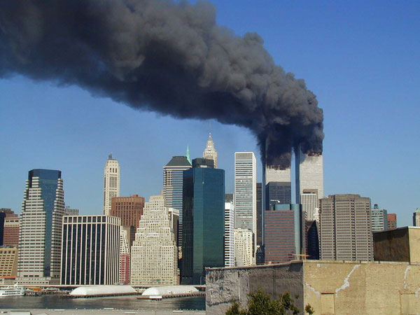 The smoking towers on 9/11. By Michael Foran.