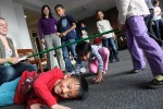 Siblings, Tyler and April Wong, 8 and 5, get creative in a game of 'limbo.' Photo by Lauren Reid.