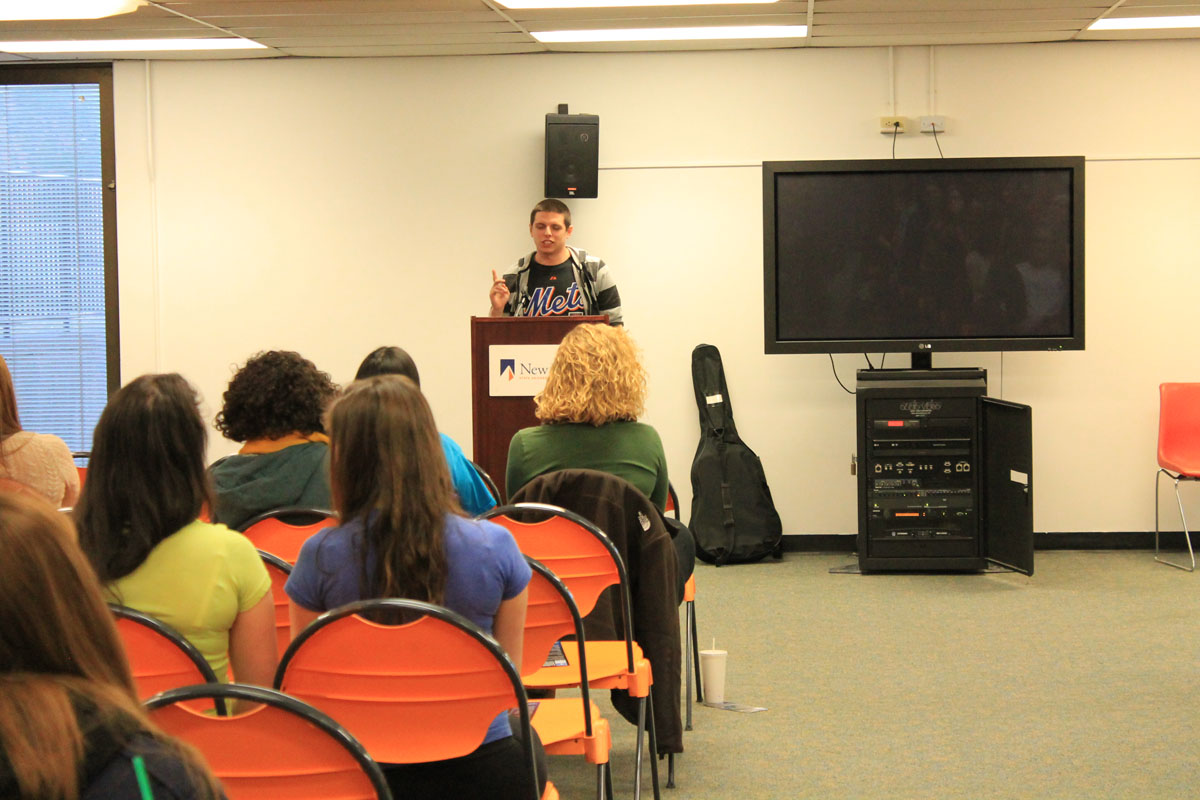 Cameron Kirkpatrick speaks to a full crowd about his affliction with Asperger's Syndrome. Photo by Audrey Brand.