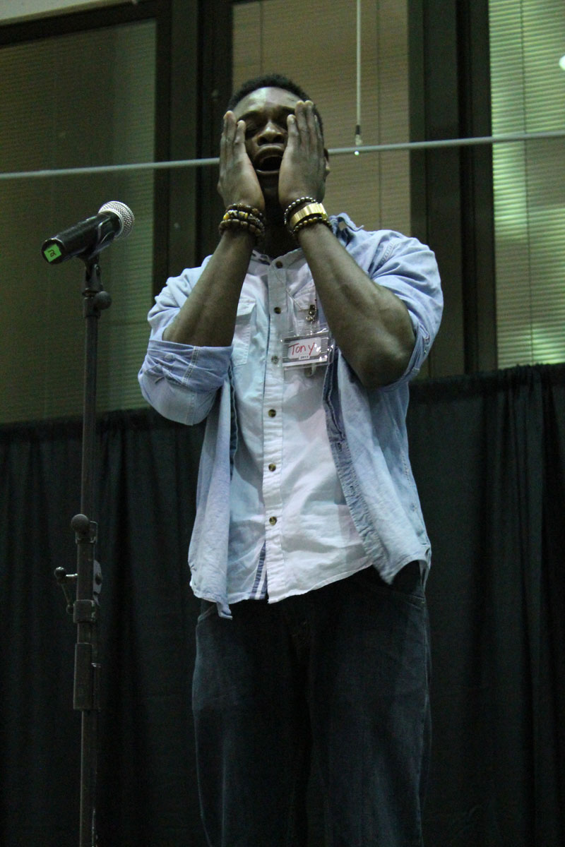 Tony, a poet performing at the slam. Photo by Audrey Brand.