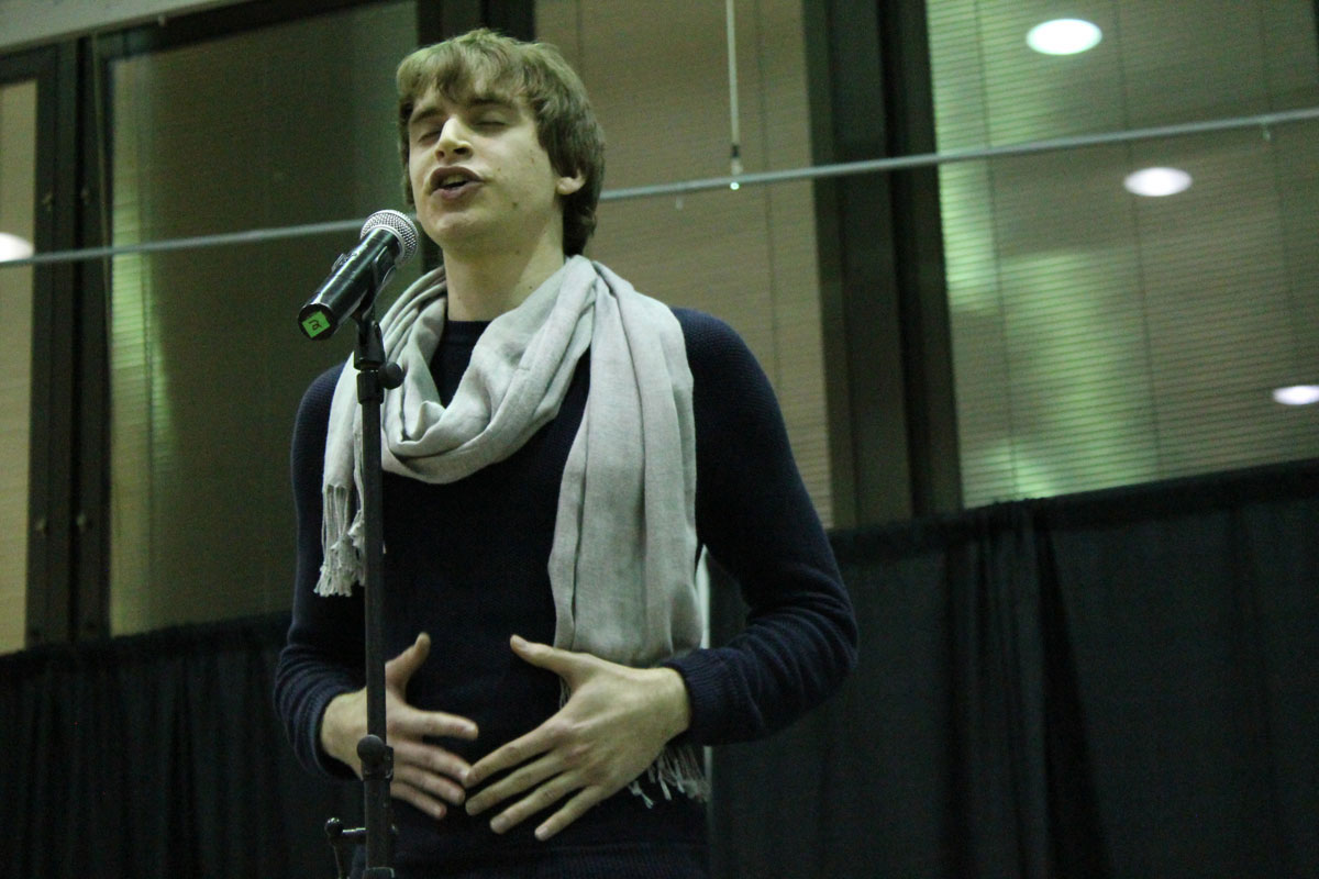 Aaron Tremper performing a poem. Photo by Audrey Brand.