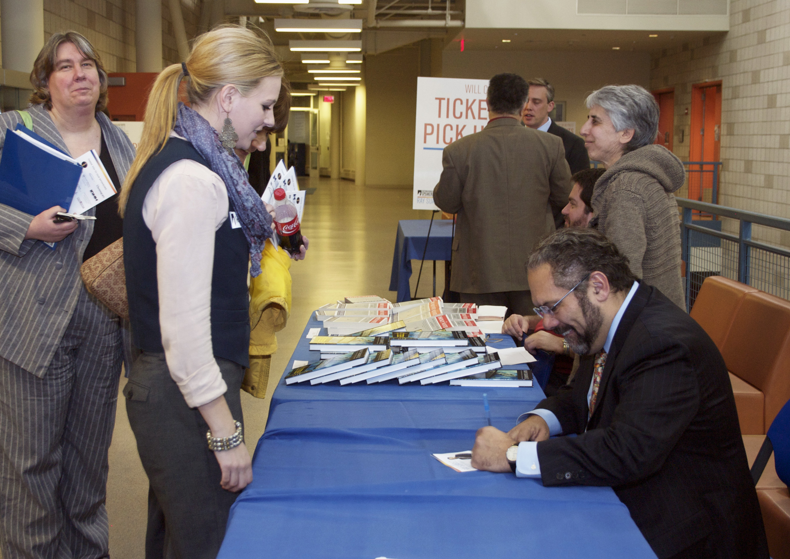 Distinguished Speaker Ray Suarez speaks with student Maggie Vasconi. Photo by Debra Trager.