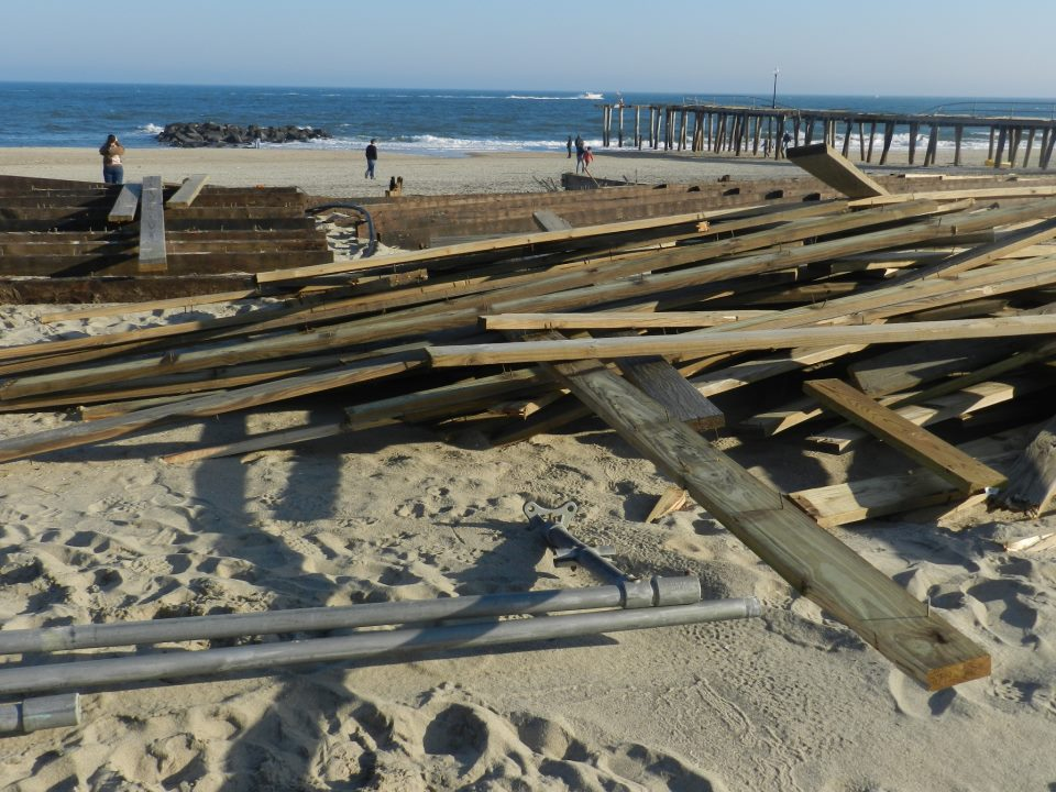 Boardwalk wood rests on the beach. Photo by Natalie De Gaetano.
