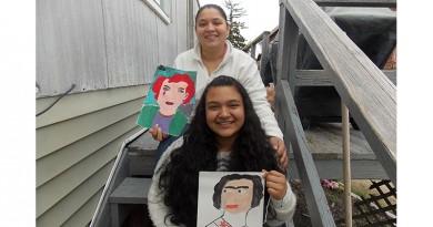 Josselin and her mother Glenia Gomez displaying Josselin's artwork.
