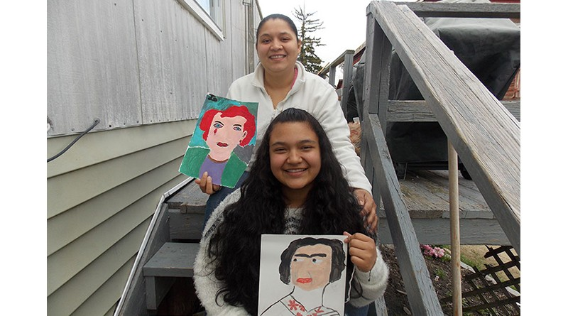 Josselin and her mother Glenia Gomez displaying Josselin's artwork.