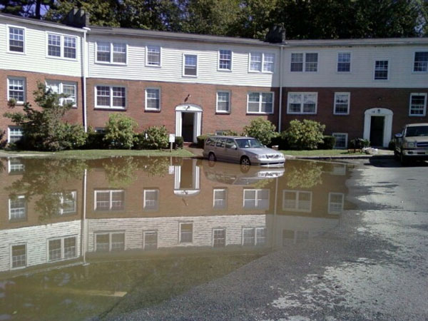 Flood waters crept up the parking lot at Town and Country Condominiums on Huguenot