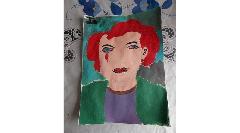 A painting of a girl crying that Josselin drew in her art class.