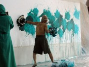 "Ushio Shinohara shows his method of ""Boxing Painting."" Photo by Ethan Genter."