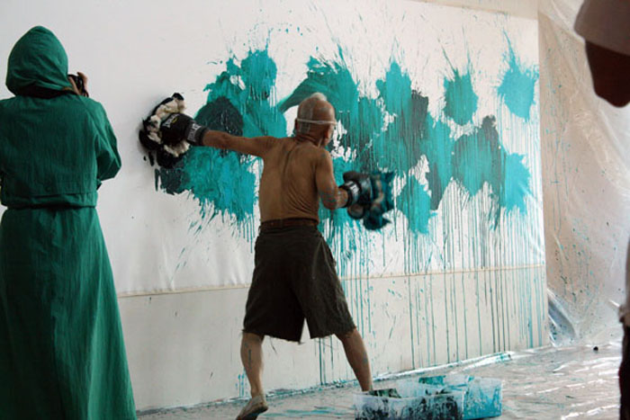 Ushio Shinohara doing his signature boxing painting.  Photo by Ethan Genter