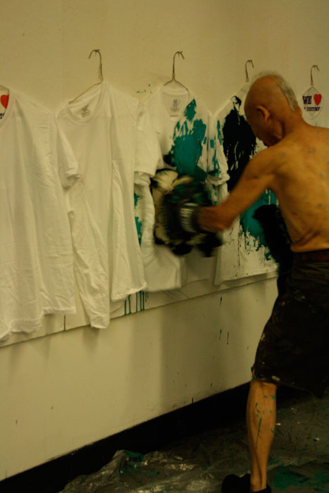 After the show, Shinohara makes shirts for donors. Ushio Shinohara doing his signature boxing painting. Photo by Ethan Genter