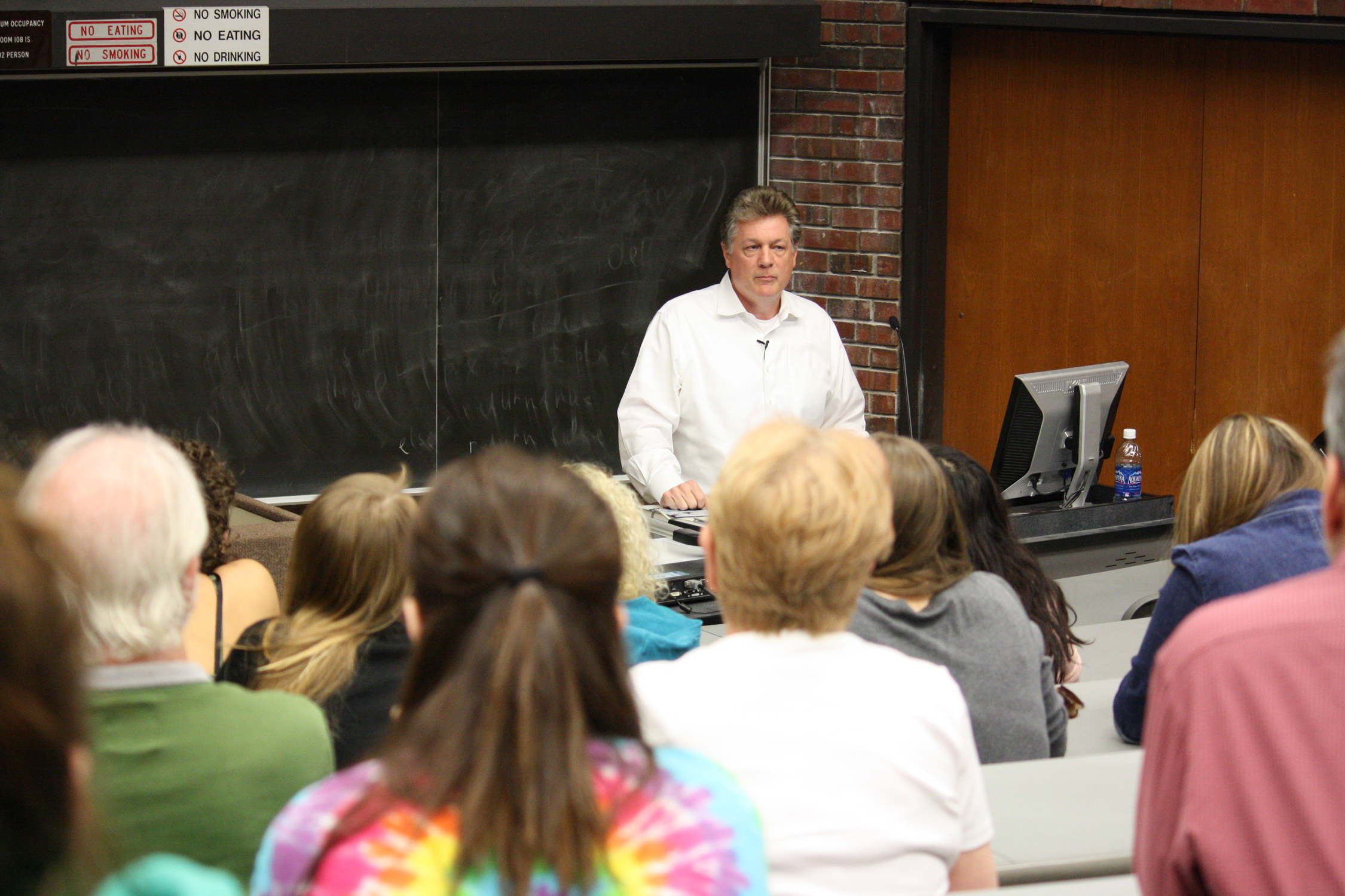 Ottaway Professor John Larson as he speaks to the crowd about his experiences as a Journalist and learning people's stories first hand.  Photo by Jade Schwartz
