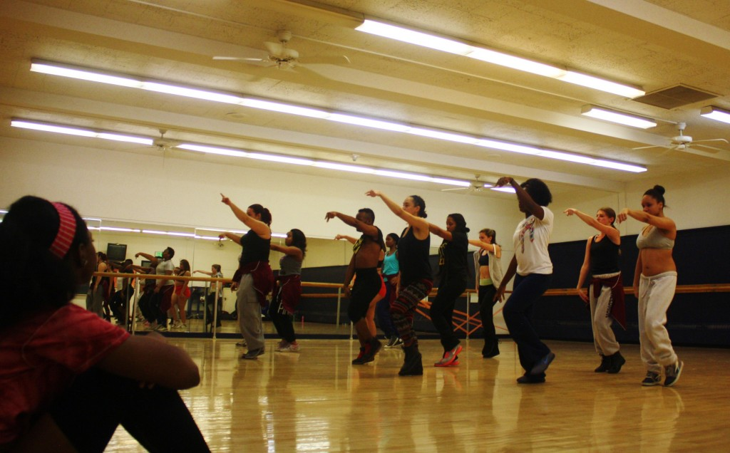 Auditionees watch while Culture Shock members perform dance routine. Photo by Hannah Nesich.