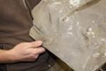Professor Bartholomew holding the fossil of a dinosaur footprint. Photo by Khynna Kuprian.