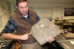 Professor Bartholomew holding the fossil of a dinosaur footprint. Photo by Khynna Kuprian.