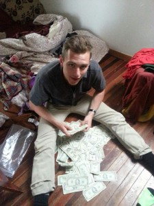 Reese Werkhoven with the cash found stashed in the couch.