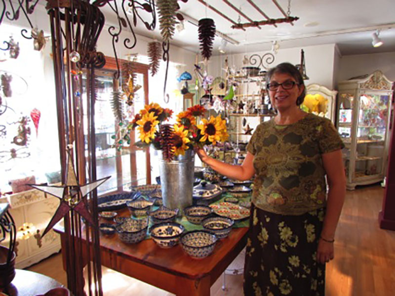 Isabella Chisena stands amongst a few of the items in her store.