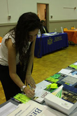 Jennifer LoCascio, a fourth-year student, fills out a raffle at the Becker Profession Education station
