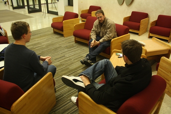 On Monday nights, a small group that is an extension of the Navigators for Christ meets on campus for Bible study in the front lobby of the library. Photo by Courtney Moore.
