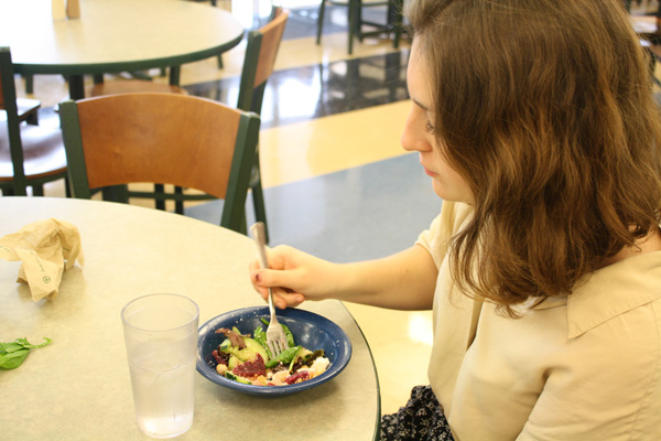 Samantha Wahl, a first-year student, enjoys a salad with friends in Hasbrouck Dining Hall. Photo by Courtney Moore.