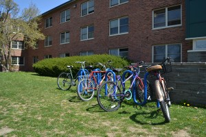 A partially full bicycle rack outside of Bouton hall. Photo by Cooper LaRocque
