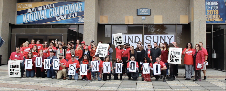 "SUNY New Campus Members hold up ""FUND SUNY NOW"" signs at the rally on Oct. 28, 2019."